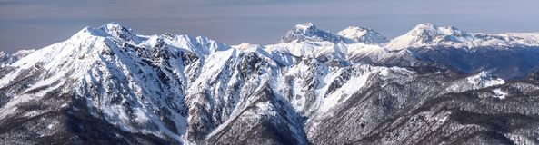Beautiful snowy Caucasus mountain peaks. Scenic winter panoramic landscape in Krasnaya Polyana, Sochi, Russia.  royalty free stock photography