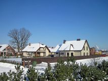 Beautiful snowy homes in winter, Lithuania royalty free stock photo