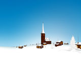 Beautiful Snowy Mountain Village Winter Landscape with Blue Sky Stock Image