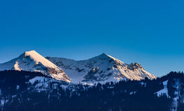 Beautiful snowy mountains, sunny day in Alps Royalty Free Stock Photography