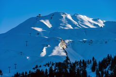 Beautiful snowy mountains, sunny day in Alps Stock Image