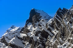 Beautiful snowy mountains, sunny day in Alps Stock Images