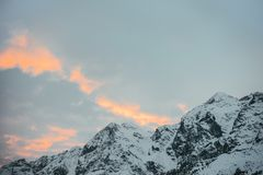beautiful snowy mountains under sunset stock photography