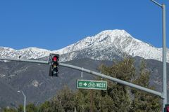 The beautiful snowy Mt. Baldy and traffic lights stock photography