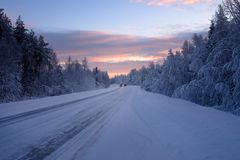 Beautiful snowy road in winter landscape Royalty Free Stock Image