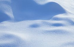 Beautiful snowy textured background, bluish colored snow abstract shape surface, close-up shallow depth of field.  royalty free stock image