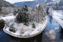 Beautiful snowy winter forest landscape, Tepla River under Brezova dam. Karlovy Vary, Czech Republic Stock Images