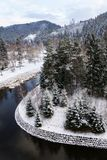 Beautiful snowy winter forest landscape, Tepla River under Brezova dam royalty free stock photo