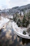 Beautiful snowy winter forest landscape, Tepla River under Brezova dam stock photo