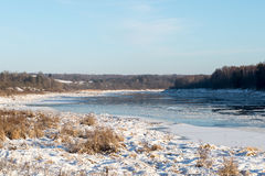 Beautiful snowy winter landscape with frozen river Royalty Free Stock Images