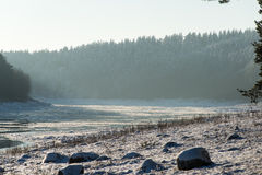 Beautiful snowy winter landscape with frozen river Royalty Free Stock Photo