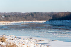 Beautiful snowy winter landscape with frozen river Stock Image