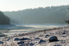 Beautiful snowy winter landscape with frozen river Royalty Free Stock Image