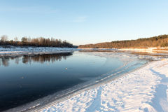 Beautiful snowy winter landscape with frozen river Royalty Free Stock Photos