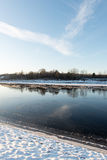Beautiful snowy winter landscape with frozen river Stock Photography