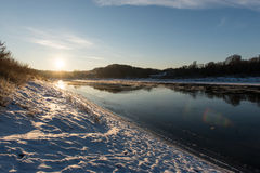 Beautiful snowy winter landscape with frozen river Stock Photo