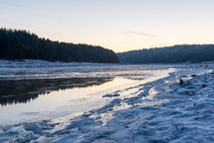 Beautiful snowy winter landscape with frozen river Stock Photos