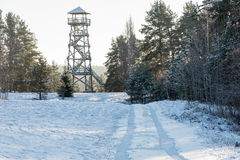 Beautiful snowy winter landscape with watchtower in forest Stock Photography