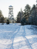 Beautiful snowy winter landscape with watchtower in forest Stock Images