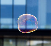 Beautiful soap bubbles fly in the city Stock Image
