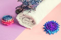 Beautiful soap in the form of flowers and towel with lavender flowers for Spa treatments on a two-tone background. Selective focus Royalty Free Stock Photography