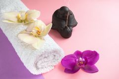 Beautiful soap in the form of flowers and towel with lavender flowers for Spa treatments on a two-tone background. Selective focus royalty free stock image