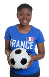 Beautiful soccer fan from France with ball Stock Photos