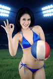 Beautiful soccer fan shows perfect sign Stock Photography