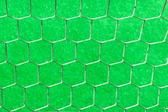 Soccer net on a green background Stock Photos