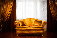 Beautiful sofa. At a window in a modern apartment Stock Image