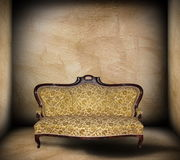 Beautiful sofa in minimalist backdrop Royalty Free Stock Photography