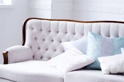 Beautiful sofa with pillows in a bright room royalty free stock images