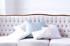 Beautiful sofa with pillows in a bright room royalty free stock photos