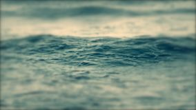 Beautiful soft focus on the surface of a sea ocean wave with white foam. Beautiful soft focus on surface of sea ocean wave with white foam close-up. Soft pastel stock video