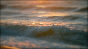 Beautiful soft focus on surface of sea ocean wave with white foam with the rays. Beautiful soft focus surface of sea ocean wave with rays of sun at sunset dawn stock video