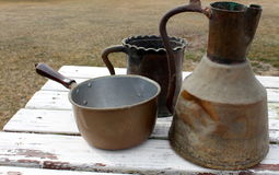 Soft patina on old copper pots Stock Photos