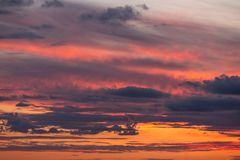 Beautiful orange red sunset sky with clouds. Beautiful soft sunset evening sky with clouds stock image