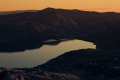 Beautiful soft sunset light over the mountain lake and the mountain. Royalty Free Stock Photos