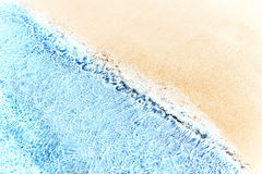 Beautiful soft waves of Blue Ocean with  Sandy Beach Background. Close up. Sea sand wallpaper Royalty Free Stock Images