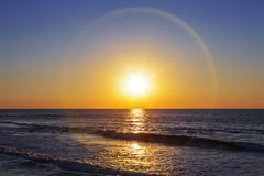 Beautiful solar halo over the sea and sky. At sunset Stock Images