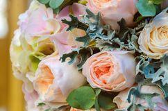 Beautiful solemn bridal bouquet of a bride from roses and eucaly Royalty Free Stock Photography