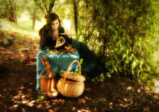 Beautiful sorceress. Waiting for someone in the woods Royalty Free Stock Image