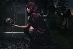 Beautiful sorceress in creepy cemetery Stock Photos