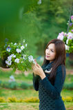 Beautiful south asian girl and flowers Royalty Free Stock Photography