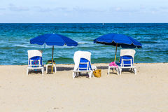 Beautiful south beach with chairs Royalty Free Stock Photography