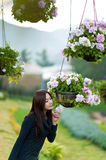 Beautiful south east asian girl and flowers Royalty Free Stock Photo