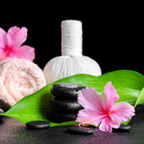 Beautiful spa background of pink hibiscus flowers, leaf, towel, Royalty Free Stock Photography