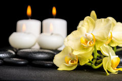 Beautiful spa background of yellow orchid phalaenopsis and candl Stock Photo