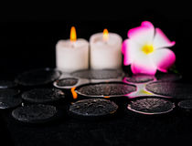 Beautiful spa background of zen basalt stones with drops, candle Stock Photography