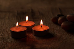 Beautiful Spa composition with aroma candles on wooden Royalty Free Stock Photos